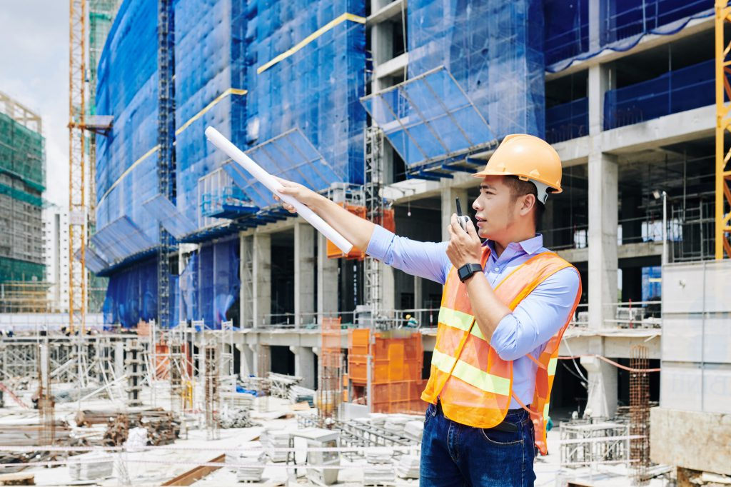 serious-civil-engineer-managing-construction-process